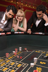 Frustrated friends at craps table