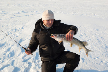 The fisherman on winter fishing