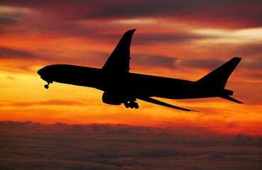 big plane landing at dawn