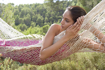 Tranquil woman laying in hammock
