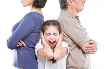 Close up of a frightened girl between her parents