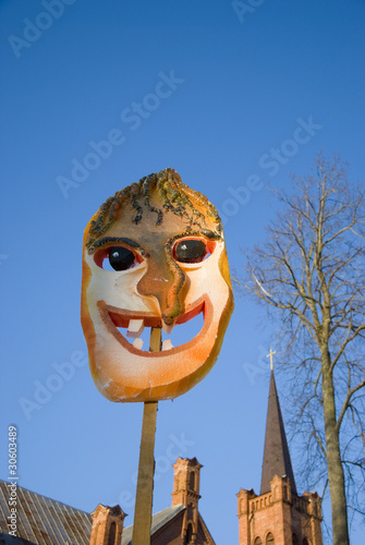 Mardi Gras mask on sky background