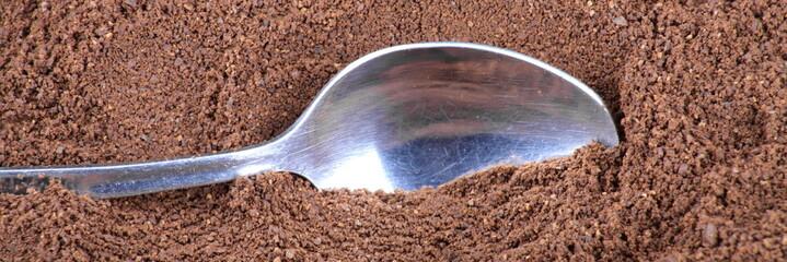 milled coffee  and teaspoon