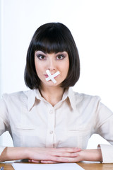 Woman with white censor tape