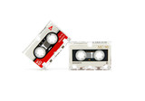 two audio cassettes on a white background.