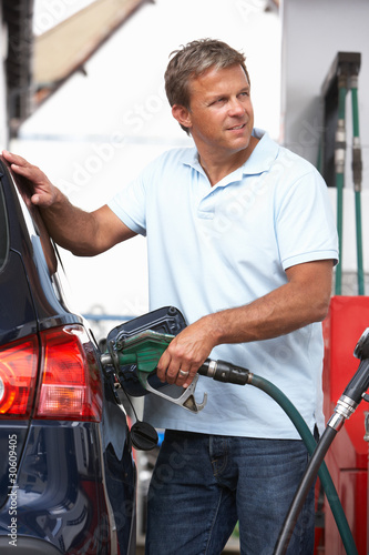 Detail Of Male Motorist Filling Car With Diesel At Petrol Statio