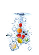 Fruit water splash with ice cubes isolated