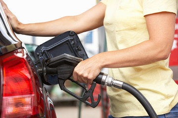 Detail Of Female Motorist Filling Car With Diesel At Petrol Stat