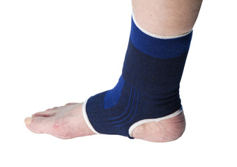 senior with ankle support on a white background