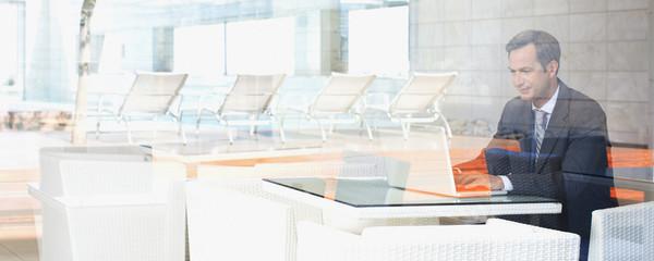 Businessman sitting in hotel lobby waiting