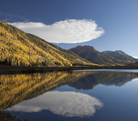 """Autumn leaves on trees on hillside next to Crystal Lake, Ouray, Colorado, United States"""