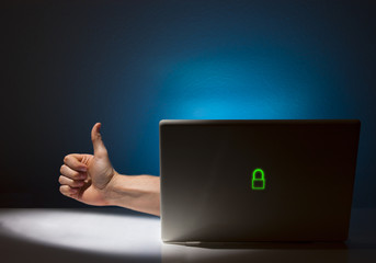 Hand Reaching Out of Computer Letting You Know its Alright