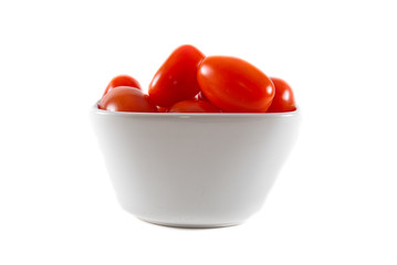 A bowl of cherry tomatoes on a white isolated background.