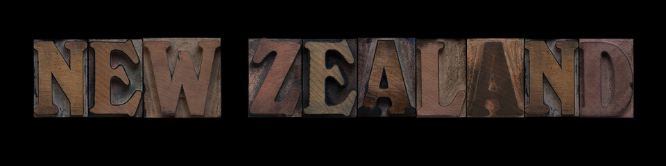 the words New Zealand in old letterpress wood type