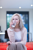 Mature woman drinking water from glass