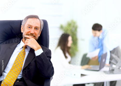 business man leading a team in an office environment
