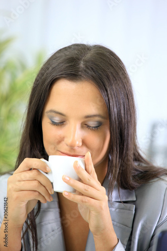 Portrait of relaxed businesswoman holding a cup of