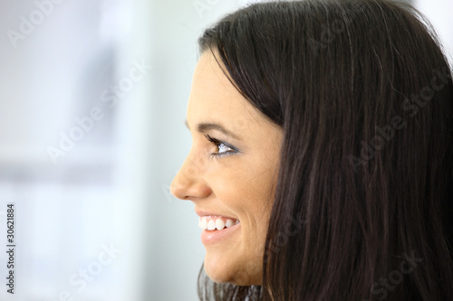 Profile portrait of young businesswoman standing with