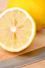 lemon on chopping board