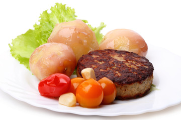 Burger with potatoes and tomatoes