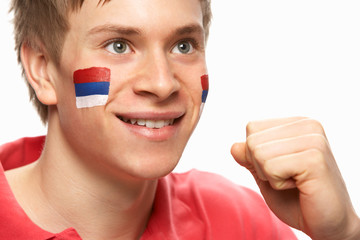 Young Male Football Fan With Serbian Flag Painted On Face