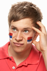 Disappointed Young Male Sports Fan With Serbian Flag Painted On