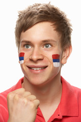 Young Male Sports Fan With Serbian Flag Painted On Face