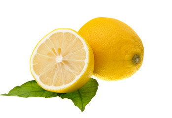 lemons on green leaf