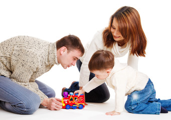 Kid and his parents playing