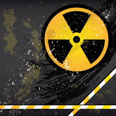 Abstract grunge background with the emblem of radiation.