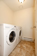 Laundry room with white washer and dryer