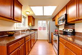 Kitchen warm maple color with stainless steal appliances poster
