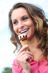 Portrait of woman eating ice cream cone