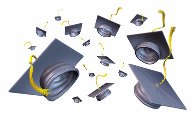 Graduation caps and mortar boards thrown in the air