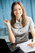 Portrait of writing happy smiling businesswoman working