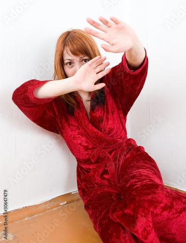 Scared abused woman is hiding