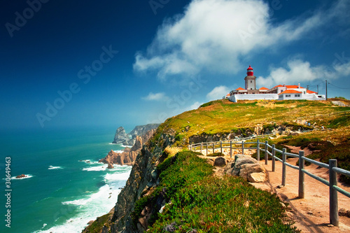 Leinwanddruck Bild Nice view of a lighthouse with the ocean in Portugal