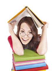 Girl in glasses with stack book .