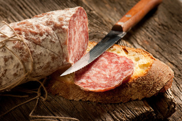 italian salami with slice bread and knife