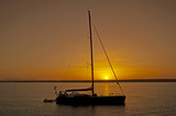 Large sailing yacht in sunset poster
