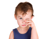 A tired little boy rubbing eyes, isolated on white poster