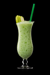 green apple cocktail on a black