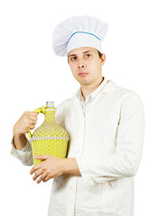 cook man in toque with bottle