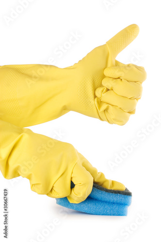 two hands in gloves with sponge