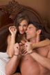 Sensual heterosexual couple in lingerie on bed