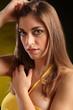 Portrait of beautiful woman in yellow top