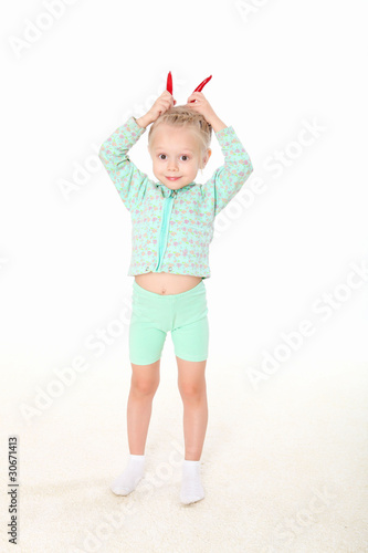 little girl doing gymnastics