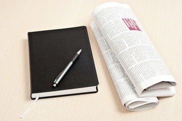 Notebook and newspaper