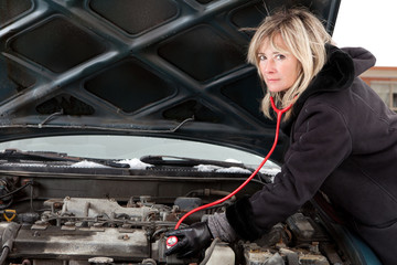 Woman figuring out what`s wrong with her car