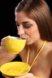 Beautiful woman drinking cup of black tea
